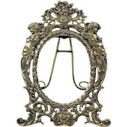 Pretty vintage 800 silver miniature portrait frame with winged nudes
