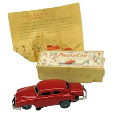 1940's Japanese tinplate clockwork trick Puzzle Car in box never used