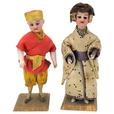 Pair antique German bisque head and arms candy containers Japanese girl and Chinese boy 8""