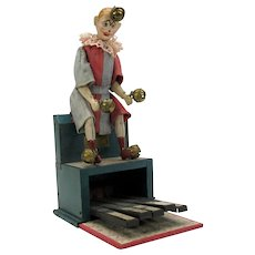 Antique French tin toy Le Clown Orchestre by Victor Bonnet