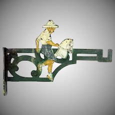 Antique figural painted cast iron child's coat/hat hook Boy on hobby horse