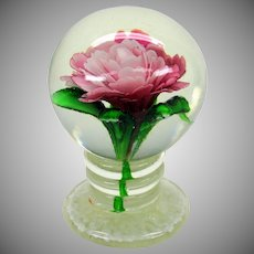 Vintage pedestal glass paperweight with pink flower