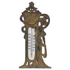Cast iron Art Nouveau figural decorated Lady thermometer for table top