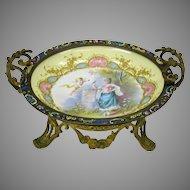 Signed porcelain bowl in gilt bronze and champleve enamel frame holder