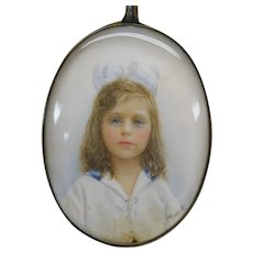 Signed portrait miniature of little girl with blue bow in original case