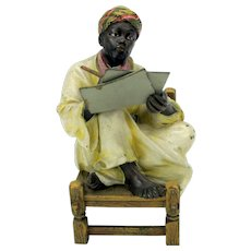 Larger Franz Bergman Austrian cold painted bronze Arab seated in chair writing a letter