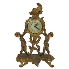 Gilded metal figural New Haven mantle clock