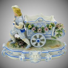Antique German porcelain figure Boys pulling flowered cart Ernst Bohne & Sohne Rudolstadt