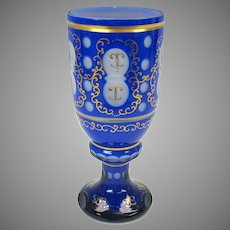 Antique cobalt cut to white overlay glass wine stem with gilded highlights