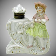 Victorian figural porcelain inkwell with young girl in hat