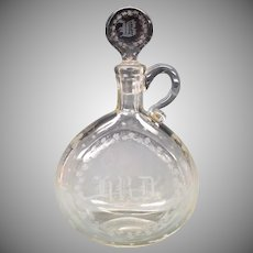 1865 Finely engraved glass decanter