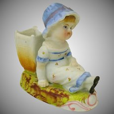 Victorian bisque Kate Greenaway girl match holder