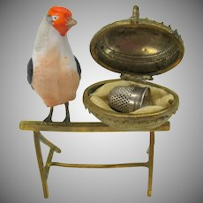 Antique novelty figural thimble holder-bisque bird on perch with egg