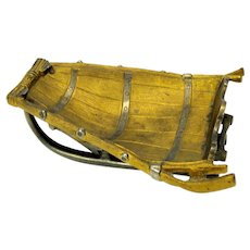 Antique gilded bronze model of a winter sled on runners-barrel form