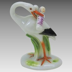 Great whimsical antique Meissen porcelain cabinet figure Stork delivering babies