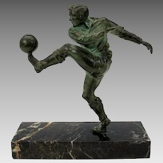 Vintage patinated metal statue of a Soccer Football player