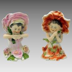 Pair of antique German bisque figures children dressed as flowers