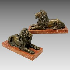 Pair of big antique bronze Lions on marble bases for mantle or shelf.
