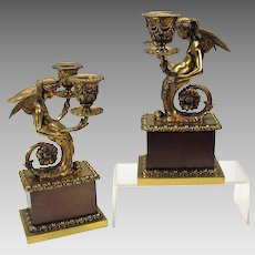 Pair of antique bronze winged maiden double candle sticks
