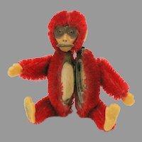 Vintage bright red Schuco Monkey powder compact