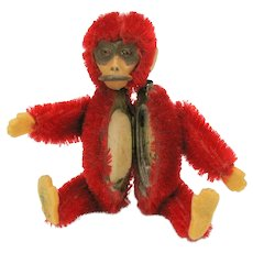 Vintage bright red Schuco Monkey powder compact
