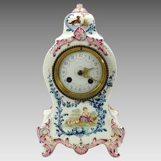 19th Century Longwy French porcelain mantle clock with dogs