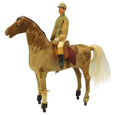 Victorian pull toy-Jockey riding skin covered racehorse on wheels