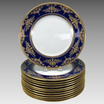 12 Royal Doulton porcelain cobalt and gold dinner plates with lavish decoration