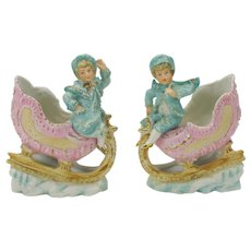 Pair of Victorian bisque figures Children in sleighs on snow