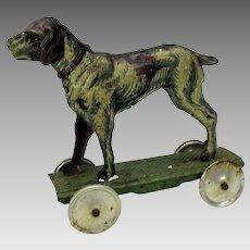 Antique German tin litho penny toy Dog on platform base with wheels