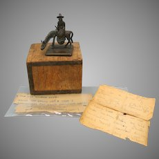 Antique Chinese bronze figural seal of Zhang Guolao with papers/box