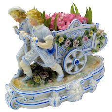 Victorian German porcelain figural centerpiece Boys pulling flower cart