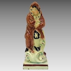 1800's Staffordshire pottery cabinet figure of Winter