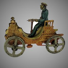 Early German tin penny toy of a horseless carriage