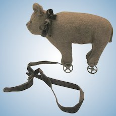 Antique early mohair bear on wheels pull toy