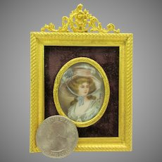 Doll size hand painted portrait miniature in French gilt bronze frame