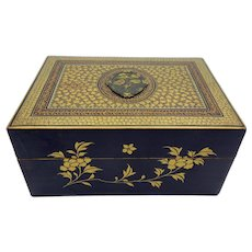 Antique Japanese Meiji period lacquer box with inlaid Shakudo mixed metal plaque