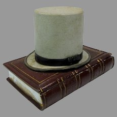 Victorian bisque figural inkwell box combination Top Hat on book box