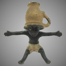Antique cold painted Vienna miniature bronze Black boy with tea cup on head