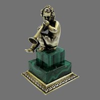 Solid 800 silver gilt cherub or Putti cabinet figurine on Malachite stone base playing horn trumpet