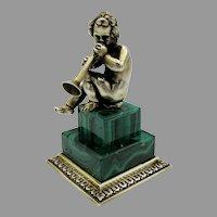 Solid 800 silver gilt cherub or Putti cabinet figurine on Malachite stone base playing horn trumpet