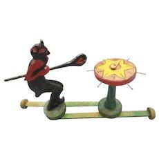Antique German painted wood Devil gambling toy semi mechanical