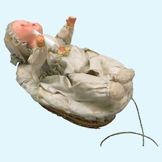 1920's German composition baby doll in basket mechanical pull toy automaton