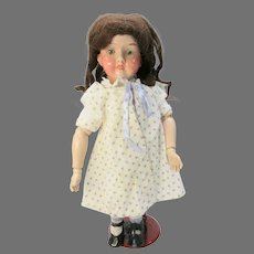 "Antique Giebeler Falk metal head wooden body 16"" doll"