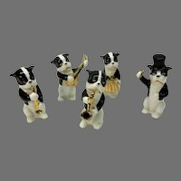 Antique German porcelain 5 piece dressed puppy dog figurine band set