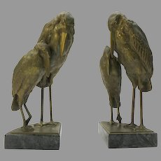 Pair of Arts and Crafts gilt metal 2 storks bookends on marble bases