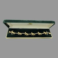 Vintage 14k gold diamond and sapphire Boston Terrier dog bracelet with full figure dogs 23.2 grams by Hunting Horn