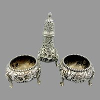 Antique Kirk sterling silver repousse pair of salt cellars and pepper shaker set