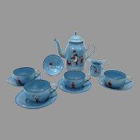 Antique toy miniature graniteware enamel decorated tea set with children & toys