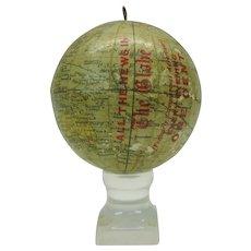 Antique hanging miniature paper globe ornament advertising the Globe Newspaper